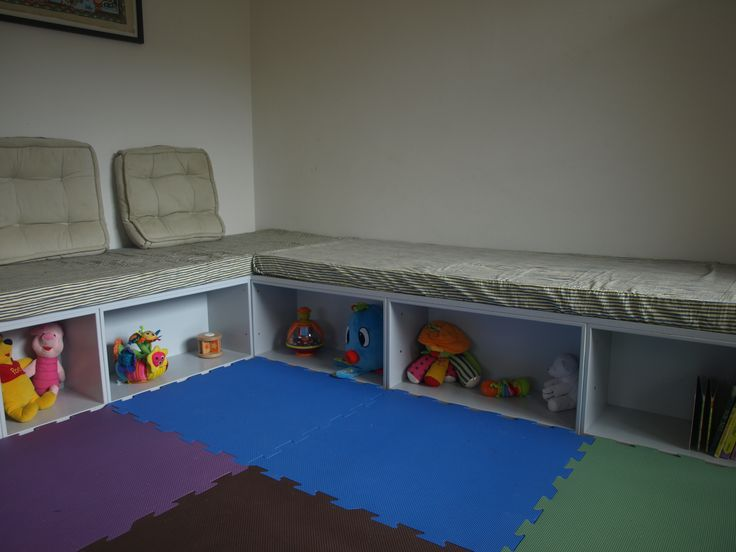 DIY baby's corner / kid's sofa. Made from painted book cases from traevarer.dk.