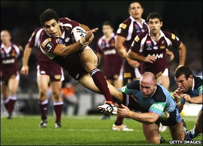 Rugby League (State of Origin game - Mal Meninga has the ball)