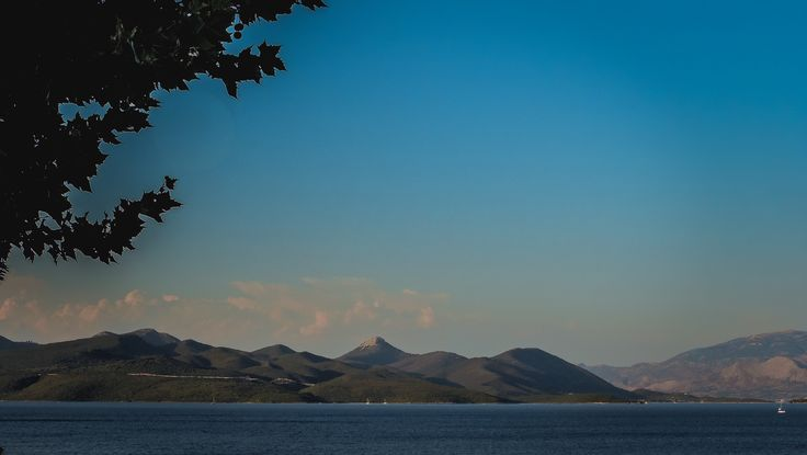 A landscape scence of the mainland viewed from Kerimedaki Taverna, Pergiali, Lefkada.