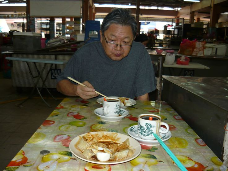 Breakfast at Ayer Panas Wet Market - my brother Victor eating leong tofu and drinking kopi oh.