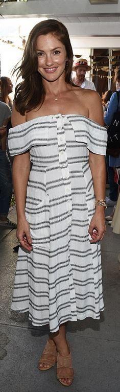 Who made Minka Kelly's white stripe off the shoulder dress?