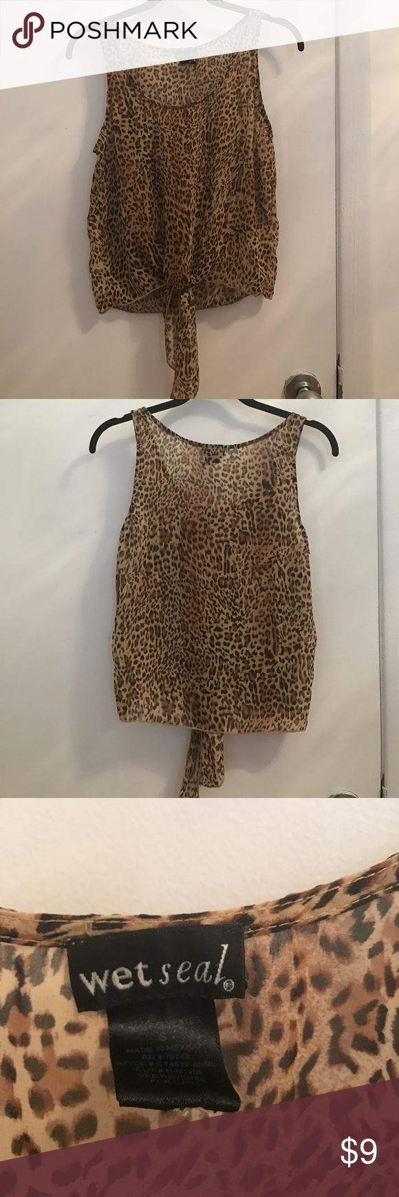 Leopard Top Upper cute leopard top! Worn a few times and is in great condition! Looks great with shorts or leggings! Wet Seal Tops