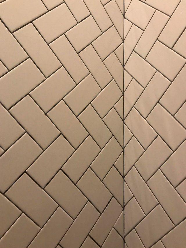 The Corner Matched Tiles In This Herringbone Bathroom Wall Oddlysatisfying Small Bathroom Tiles Tiles Bathroom Wall