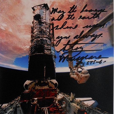 "Story Musgrave's Hubble Spacewalk from Space Shuttle Mission STS-61. Handsigned, Signiture reads: ""May the Heavens and Earth Shine upon you always. Story Musgrave""  Comes with a Certificate of Authenticity. http://www.thespacestore.com/stmuhusp.html"