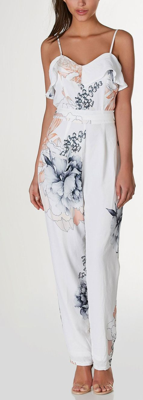 Chic sleeveless jumpsuit with flirty ruffle trim at neckline and adjustable shoulder straps. Waist tie detail with floral print throughout. Straight leg fit and hidden back zip closure. - 100% Polyest