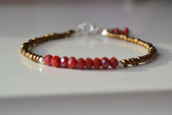 Friendship bracelet, layering bracelet, karma bracelet -Czech brun Stones.  Wonderful gift idea.Very comfortable bracelet, you can wear this all day through.Look very delicate and beatiful on.This bracelet are made by me in Montreal, Canada.Unique handmade jewelry bracelet.     The bracelet are made whith:  -red rubies stones  -brun Czech glass seed beads  -sterling silver spring ring closure -This braclet mesure 7 -almost 18 cm  - Handmade by me in Montréal ,, Canada  -Also available in…