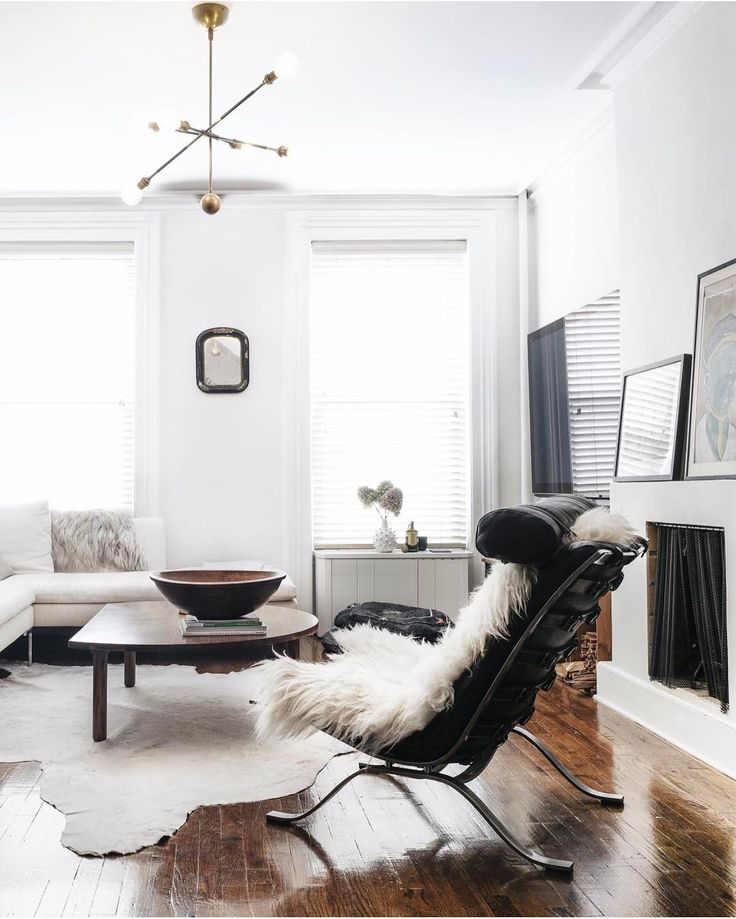minimalist modern living room with leather chair + sheepskin