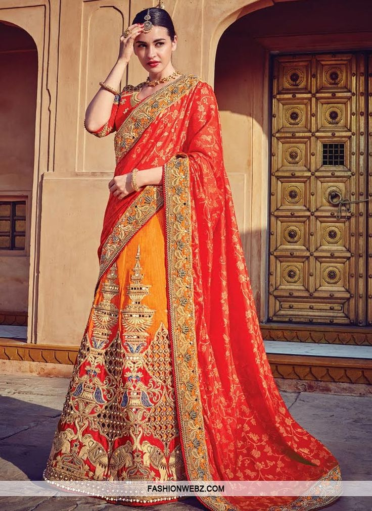 Attract compliments by this #orange and #tomato #silk #lehenga #saree.