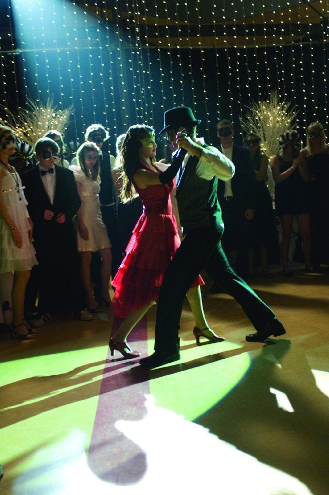 Still of Drew Seeley and Selena Gomez in Another Cinderella Story  I've always liked the idea of a masquerade ball. Selena Gomez looks stunning in this red cocktail dress and golden mask.