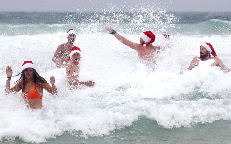 Despite wet and cold weather, British travelers don't give up on a celebrating dip at Bondi Beach in Sydney, Australia. #Aussie #Holiday