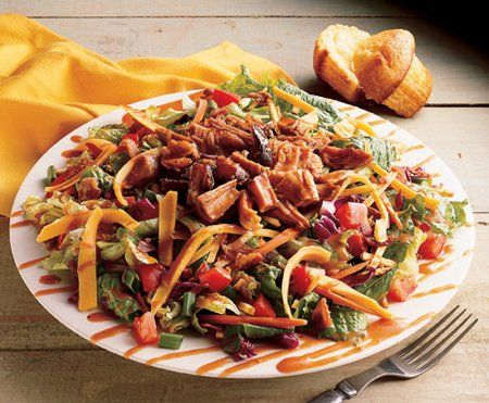 BBQ Pork Salad-copycat  I've gone to a BBQ restaurant in the south and they serve a pulled pork salad that is to die for.They top their garden salad (with tomato, cucumber, cheese, etc) with their pulled pork and then mix together Ranch dressing and some BBQ sauce as a dressing for the salad. It is a VERY good and filling meal. I like it with some cornbread too. YUM! **great way to use up those left-over BBQ ribs...