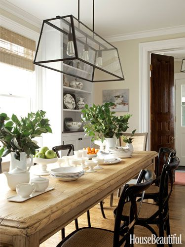 Breakfast Area - An elm table from Hammertown gives an instant sense of warmth to the breakfast area. Eldridge chandelier from Ballard Designs. Walls painted Benjamin Moore Aura in Edgecomb Gray set off the white cabinetry and dishware.