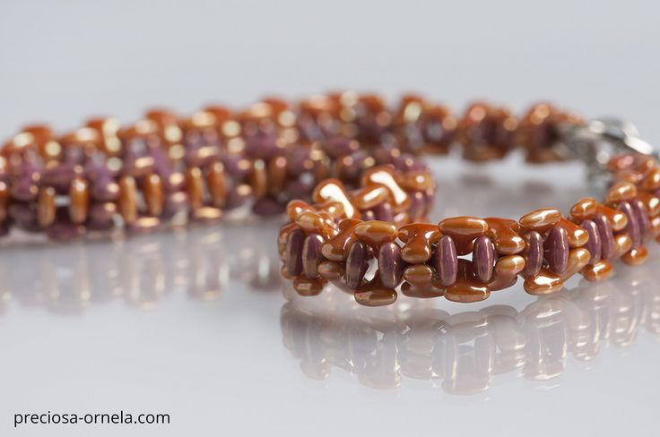 "Design: Katerina Krausova  PRECIOSA ORNELA presents the new PRECIOSA Tee™ pressed bead from the PRECIOSA Traditional Czech Beads™ brand. Its dimensions of 2 x 8 mm conform to the current trend in mini-beads. The axially symmetrical flat shape of the letter ""T"" enables the application of vacuum half-coatings on both sides of the bead with the resulting effect of an allover coating and other popular surface coatings. The strung beads closely interlock and create an interesting zip effect. It…"