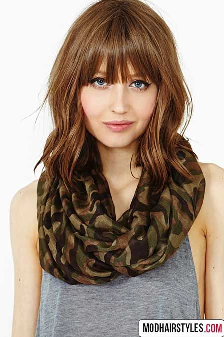 6. Medium Length Hairstyles with Bangs and Layers