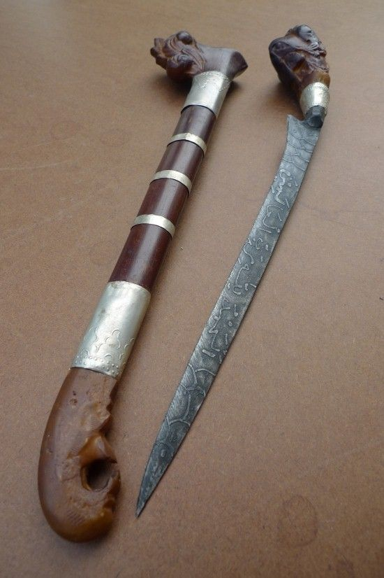 Sale > Weapons > PATTERN 3: BADIK TUMBUK Jawi Verse Blade Keris Weapon Knife Dagger Sword Kris#11 Borneoartifact item number: WE 01725 A traditional Malay dagger/Badik Tumbuk used as a weapon of defense or for domestic purposes such as slaughtering animals, or cutting meat or onions. The blade of a badik is forged from steel for durability, decorated with Holy verses of the Quran Bible. Scabbard & hilt made traditionally from real latex of the rubber tree. New. Total: 38 cm / 15 inches ...