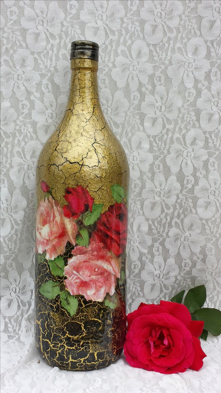 ALTERED BOTTLES Spray painted with primer, then acrylic paint w/crackle  medium and decoupage w/paper roses. Could use napkins or scrapbook paper.