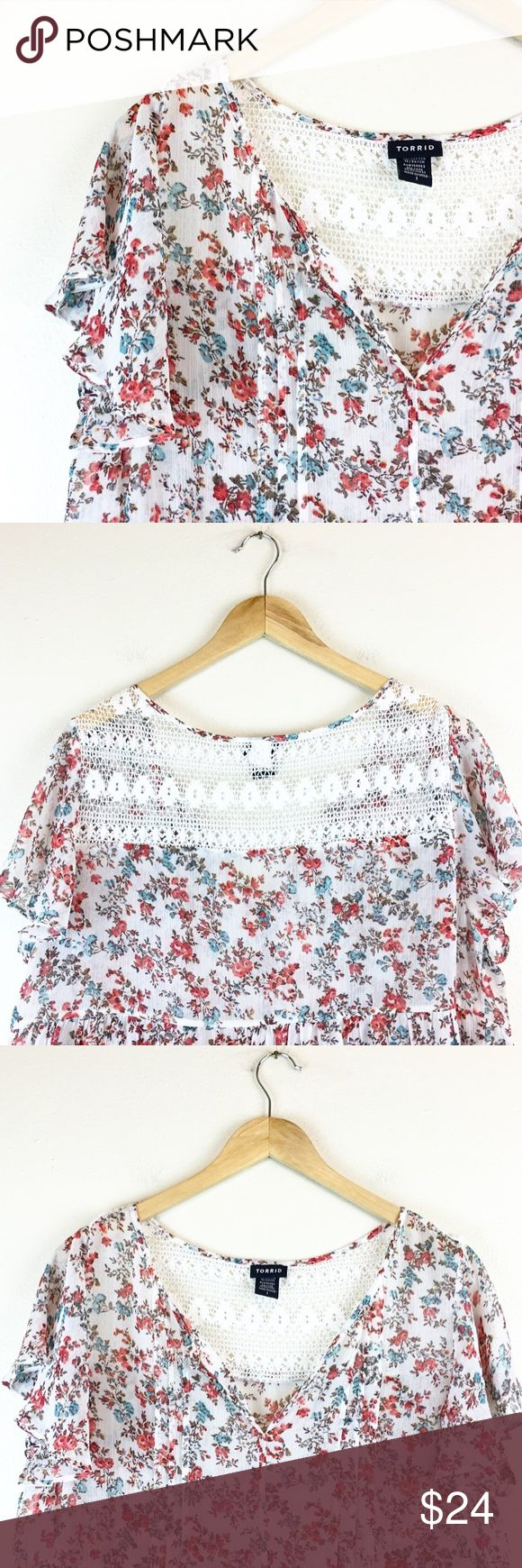 """Torrid Women's Floral Short Sleeve Blouse Size 1 Torrid Women's Floral Blouse  Size: 1  Measurements:  Bust - 21"""" armpit to armpit, laying flat Length - 28"""" taken from back of garment, top to bottom  Great Pre Loved Condition!  HAPPY POSHING! torrid Tops Tees - Short Sleeve"""