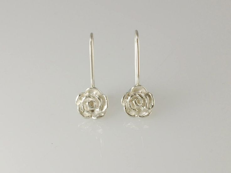 "-Rose Drop Earrings- NZ$89- Silver Give the gift of everlasting love with our silver Rose drop earrings, they will never wilt and are sure to last a lifetime! For centuries the rose is has been a symbol of ""Love"". The tradition of giving flowers dates back to the ancient Greeks and has been elaborated by the Victorians to giving entire bouquets. Range also includes hoop earrings, and pendants. Rose size 9.5mm, earring length 25mm approx. Jewellery made @jewelbeetle in Nelson, New Zealand."