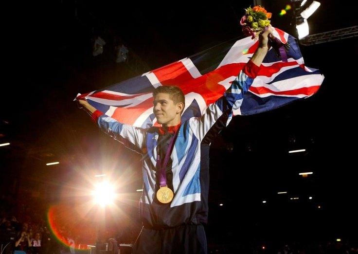 Gold medalist Luke Campbell of Team GB celebrates after the medal ceremony for the Men's Bantam (56kg) Boxing final bout. (Photo by Scott Heavey/Getty Images) 2012 Getty Images.   https://www.facebook.com/TeamGB