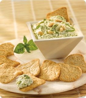 Pepperidge Farm®  Pesto Cottage Cheese Dip - Served with toasted wheat crisps, this savory dip combines cottage cheese and store bought pesto, accented with fresh basil and toasted pine nuts to make a scrumptious appetizer.