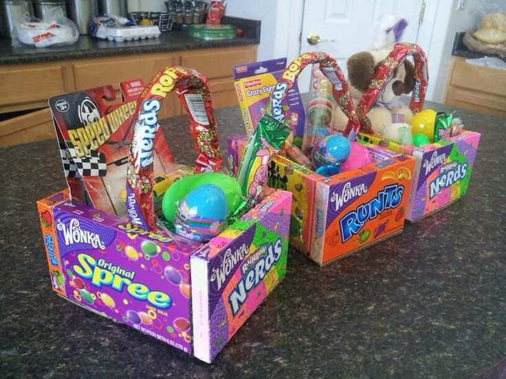 Edible Easter Baskets - Glue four large boxes of candy together, hot glue a piece of cardboard for the bottom of the basket. Fill with a little plastic grass ans more goodies...