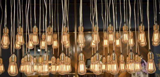 Multiple old style hanging light fittings making a pretty cool feature.