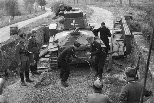Erwin Rommel and a Pz38t tank on a bridge passing in France 1940. 7 Panzerdivision.