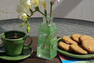 Decoupage decorated old bottle as new vase. Pimp your spring desk! :)
