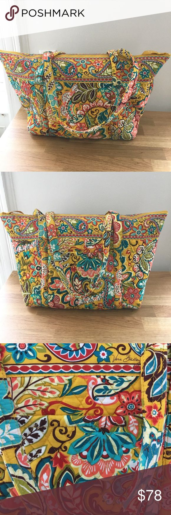 Vera Bradley Travel Bag Vera Bradley Travel Bag. Great for weekend getaways or a carry on travel bag. There are two over the should straps and six pockets on the inside, one pocket on the outside. Great shape barely used Vera Bradley Bags Travel Bags