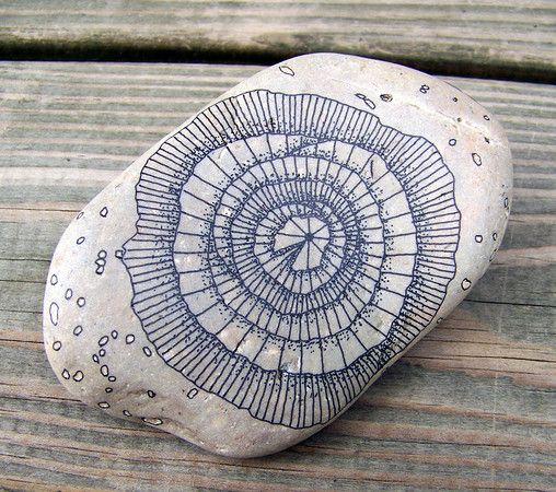 Rock 6: Micron pen (ink) on rock. August, 2012.  About 7 inches in length.
