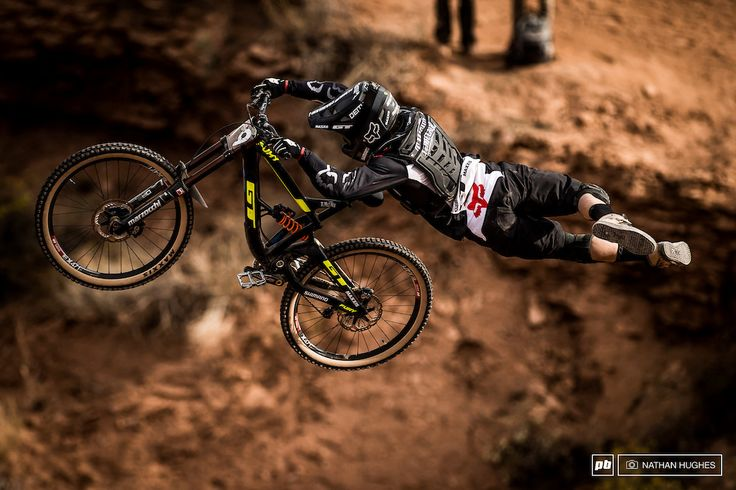 Tyler McCaul stretching out after a long descent in the saddle down to his big hip jump.