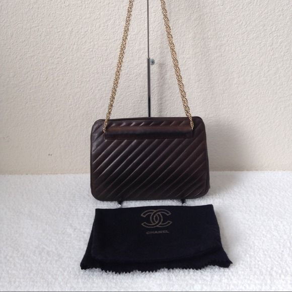 "HPDate Night 11.21.14 Authentic CHANEL bag 100% authentic Chanel.9.5x2.5x7"".Dark chocolate brown,Gold hw.Double nonadjustable shoulder strap,15"" drop.MADE IN FRANCE.In GREAT early 1980s VINTAGE condition.Leather is still very soft.No tears,cuts or pen marks,minor wrinkles & darkening. Hw is a little tarnished & sides have scrapes/rusting only obvious w/ detailed inspection.Shoulder strap & snap have color fading,aged greatly.No serial number & no authenticity card.It comes w/ its original…"