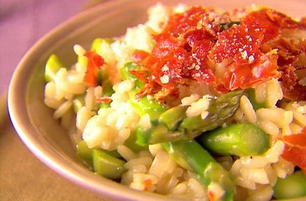 Champagne Risotto with Asparagus and Pancetta | This champagne risotto recipe incorporates salty pancetta and earthy asparagus to achieve a well-rounded flavor that's hard to pass up.