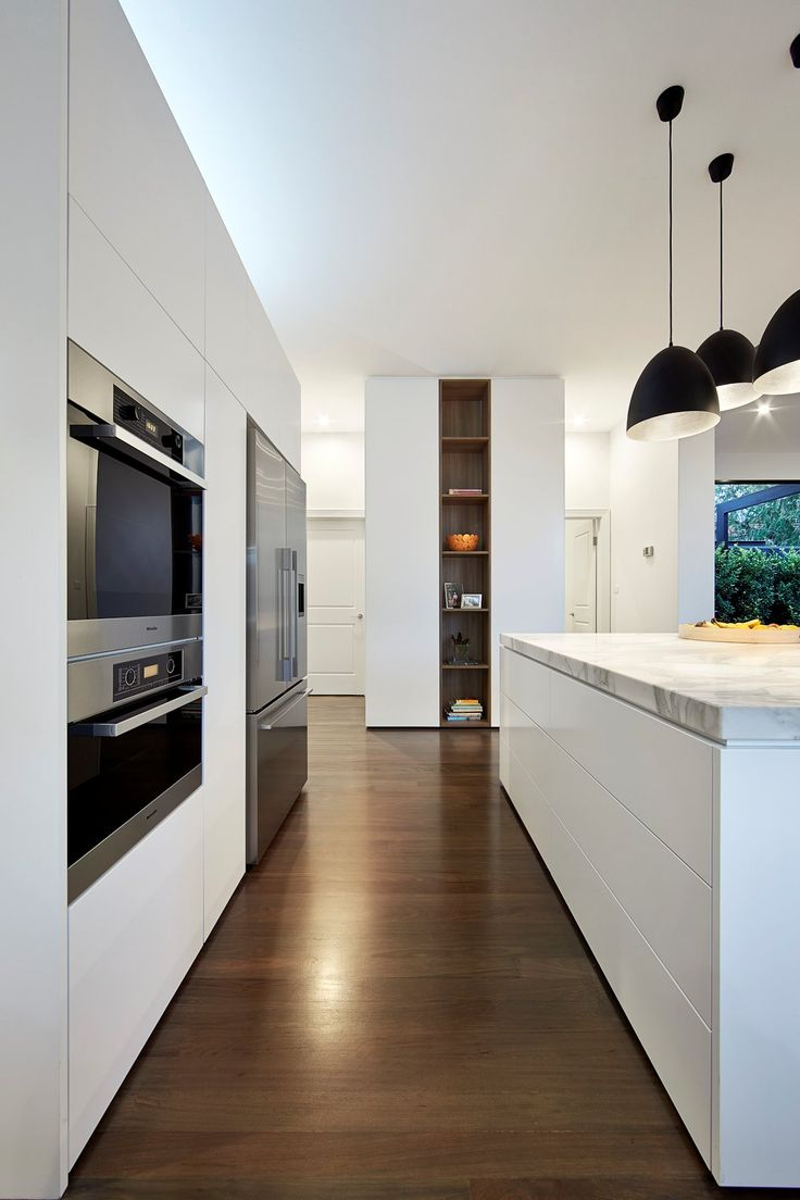 White cabinet and wood shelving