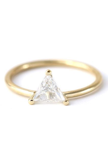 """20 Minimalist Engagement Rings That Scream """"I Do"""" #refinery29  http://www.refinery29.com/minimalist-engagement-rings#slide-11  A simple band doesn't have to lose all its shine.Artemer Trillion Diamond Engagement Ring, $3,200, available at Etsy...."""
