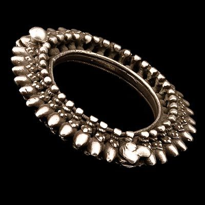 Silver Bracelet  ~  Madhya Pradesh, India ~ Circa 1900 ~ The fine level of detail circling the solid silver band shows hours of painstaking work. Unfasten using the hinge and screw.