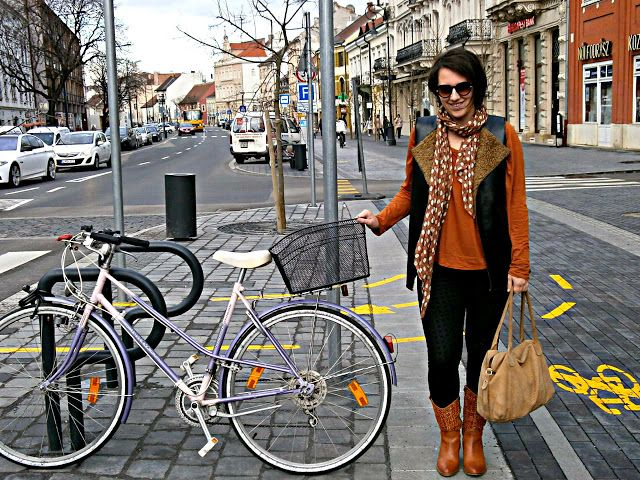 VGRV blog, orange Nanushka shirt, boots in 70s style, black pants, nude suede bag, faux leather vest with faux fur, printed scarf, Sopron, retro bicycle, hungarian designer