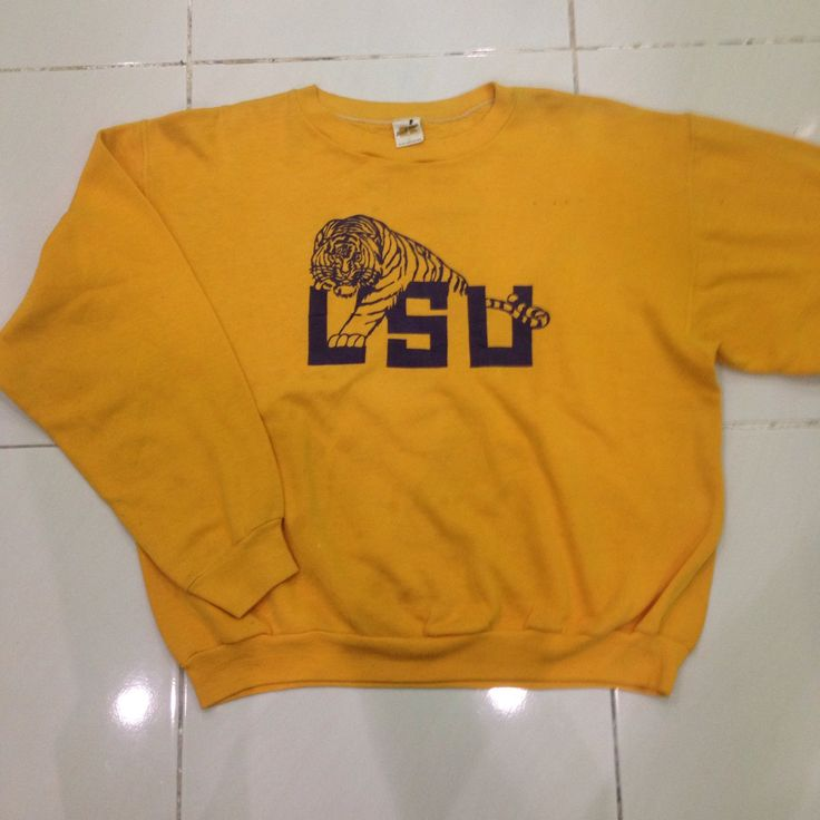 vintage 70s / 80s Louisiana State University / LSU tiger / long sleeve pullover sweatshirt / sweater / crewneck / knitwear russell athletic by bintangclothingstore on Etsy https://www.etsy.com/listing/500504535/vintage-70s-80s-louisiana-state
