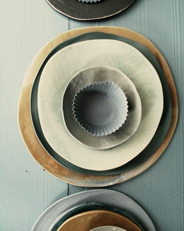 a plate set in moody tones , combination of glazed stoneware and porcelains ( all signed with my initials DW the year and month when it was produced ( made by dietlind wolf)