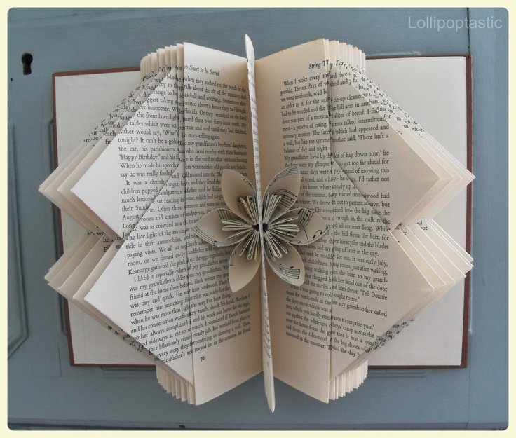 Hand-folded book art featuring a beautiful origami flower.