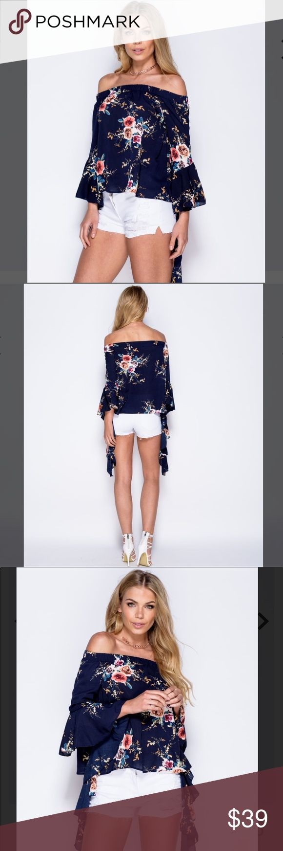 🌸 Bardot Off-Shoulder Floral Top - Navy 🌸 Hit all right style notes this season with this bardot off-shoulder, flowy floral top with flared sleeves. Precious with white shorts or distressed skinny jeans! (Also available in Wine in another listing.) *Sizes are SM/M or M/L. Please specify size when ordering a medium or selection will be made for you. Thank you!*  Floral off the shoulder bardot top Long flared sleeves Crepe fabric Model is a UK size 8/US size 4 and her height is 5'8 Beauty…