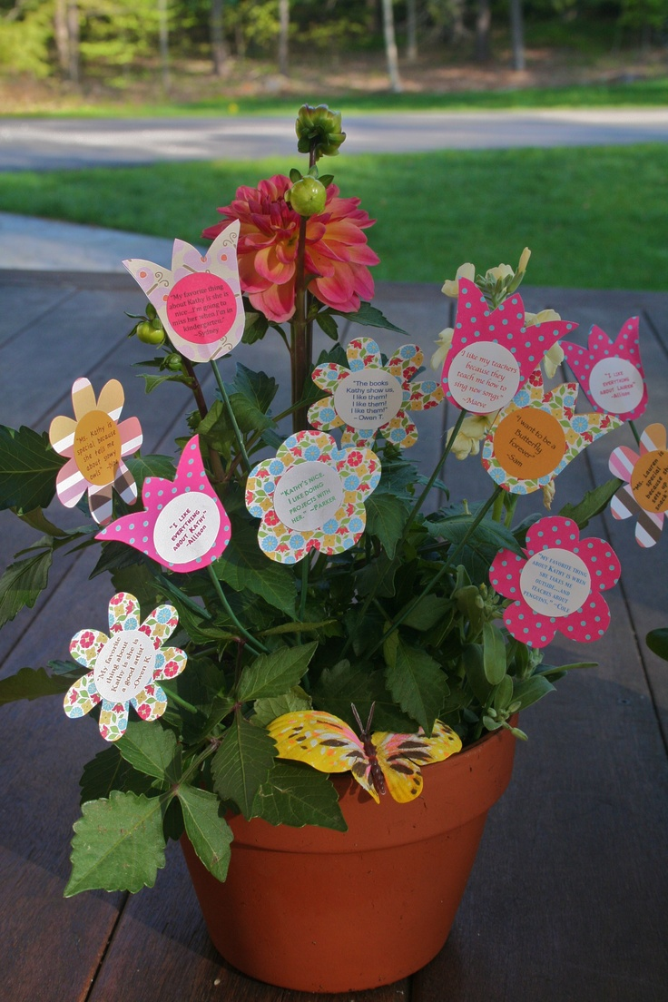 """Teacher Appreciation Day   Dahlia Planter with paper flowers added with quotes from the kids...saying what they like best about their teacher.  It's a real flowering plant.  I bought fake flowers at dollar store, removed the blossom but used the green wire """"stem"""" to add my own paper flower!"""