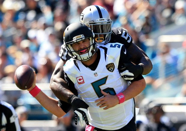 Raiders vs. Jaguars:     October 23, 2016  -  33-16, Raiders  -    Blake Bortles #5 of the Jacksonville Jaguars is tackled by Bruce Irvin  of the Oakland Raiders during the game at EverBank Field on October 23, 2016 in Jacksonville, Florida.  (Photo by Rob Foldy/Getty Images)