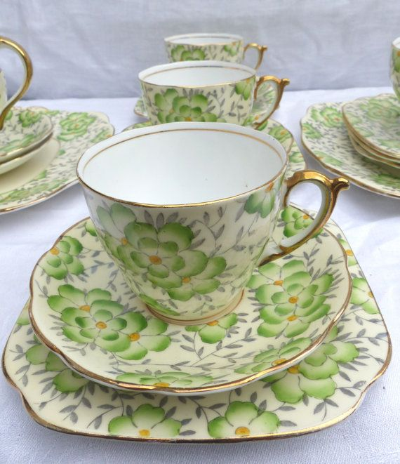 This is a beautiful 6 setting service with a fresh green and gilt floral pattern on a cream background. This Roslyn Metz vintage bone china tea set was