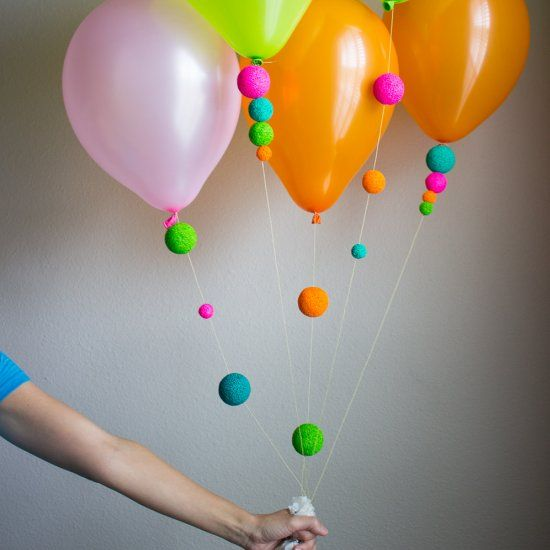 Add some unexpected color to balloons by stringing on painted foam balls. So easy and so FUN! Perfect for summer & birthday parties!