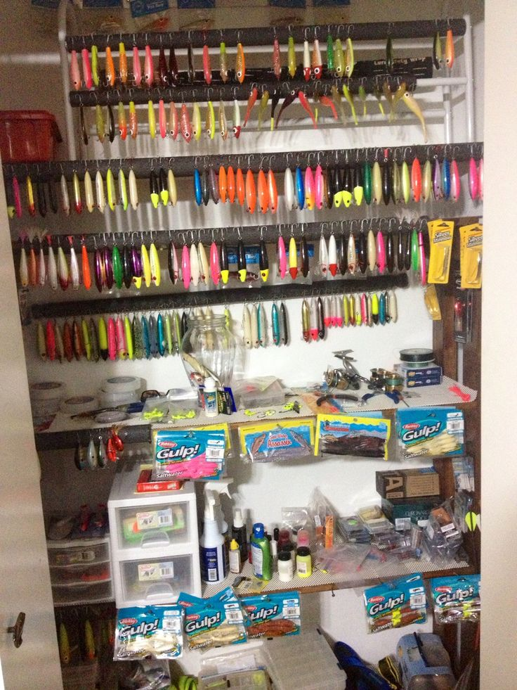 Spare closet, fishing lure organization Looks like rods were coated in foam (like pipe insulation) to use for hook hanging...
