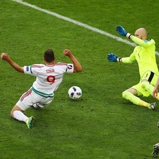 Ádám Szalai (L) of Hungary scores the opening goal