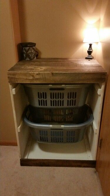 Just finished this laundry basket holder for the wife. Made out of 1/2 plywood and pallet wood. Very easy to make, and fit perfectly for the space