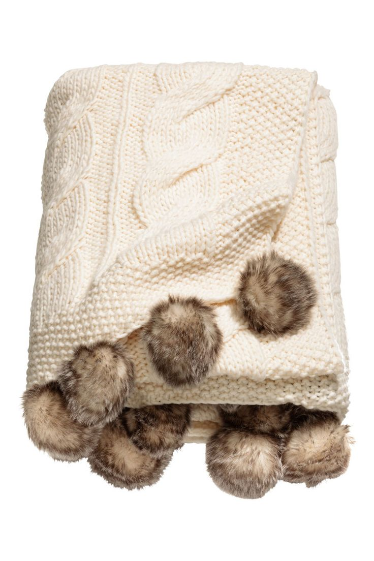 White. Throw in a soft cable knit with wool content. Faux fur pompoms at short sides.
