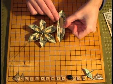 FLOWER (origami) FOLDING with MONEY.  Wonderful youtube video!  Her origami flower is super easy to make and uses 3 bills per flower.  Tip:  When I need a short piece of wire I remove the paper from a bread twist-tie, using the exposed wire on my project.